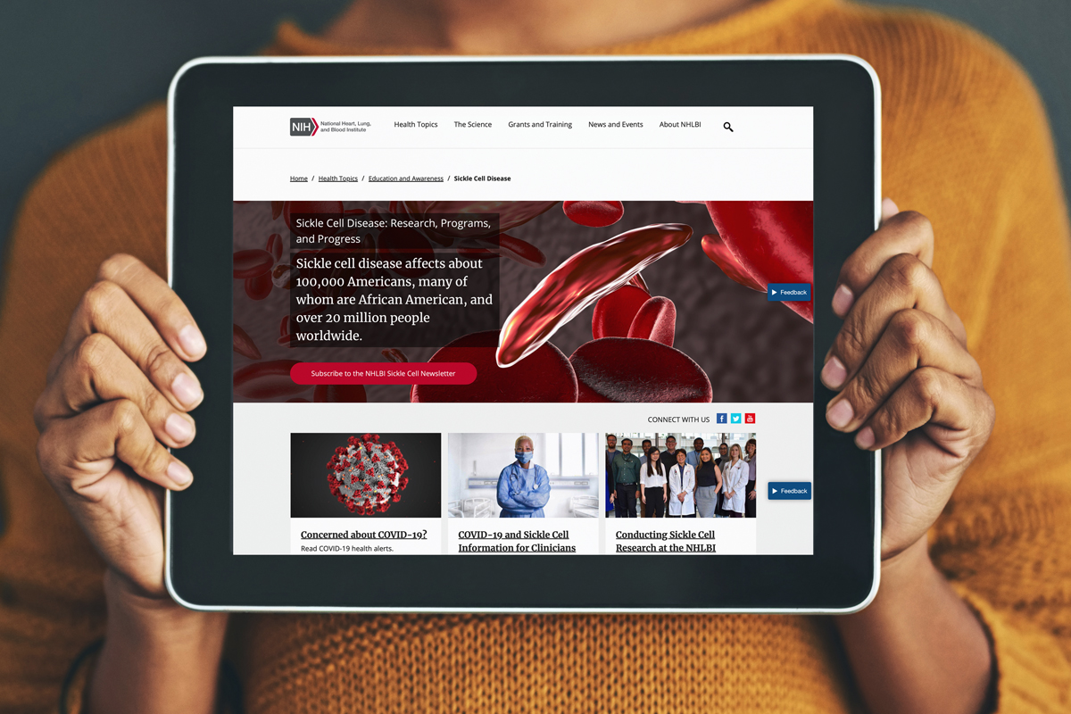 Woman holding tablet showing NHLBI Sickle Cell page